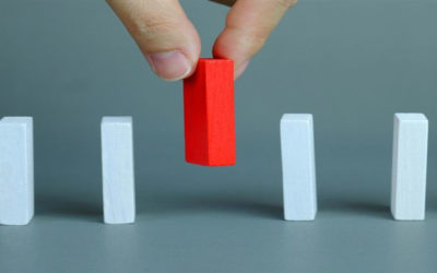 Red domino being chosen in a row of white standing out choosing